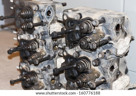 Close up shot of car engine reparation - stock photo