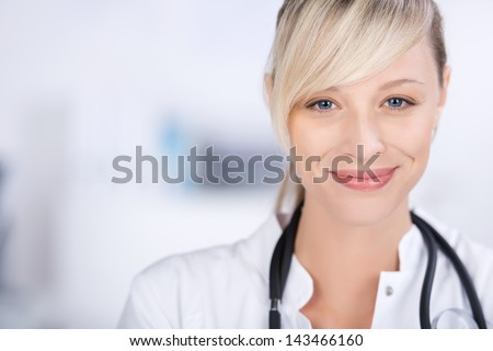 Close up shot of cheerful doctor over the white background - stock photo