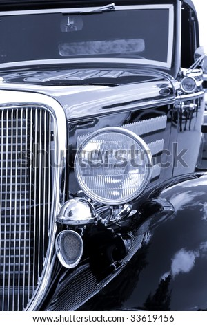 Close up shot of classic car in black and white