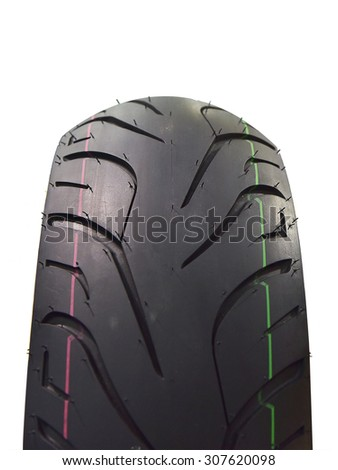 Close-up shot of classical motorcycle tire tread isolated on white background. This has clipping path. - stock photo