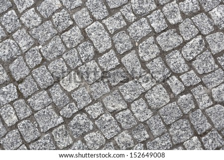 close up shot of cobblestones on the pavement - stock photo