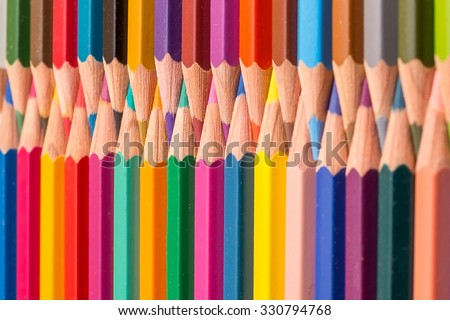 Close up shot of color pencil on wooden background as kids, office, art work,  and creative use purpose (with selective focus on color pencil) - stock photo
