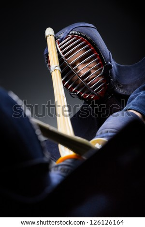 Close up shot of competition of two kendo fighters. Japanese martial art of sword fighting - stock photo