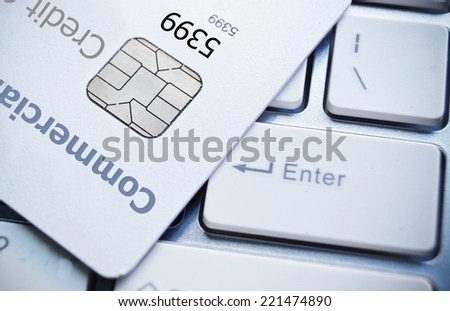 Close up shot of credit card and computer keyboard - stock photo