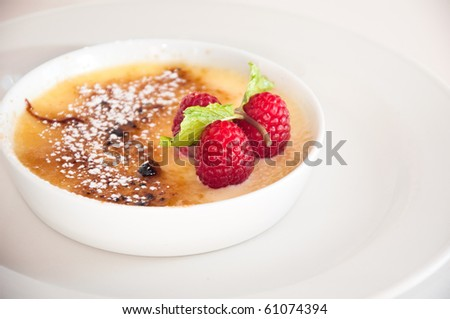 Close up shot of creme brulee dessert over white background - stock photo