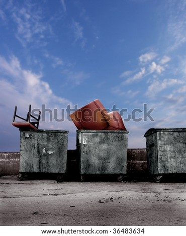 close up shot of dirty dumpsters with old furniture - stock photo