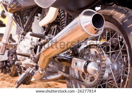 close up shot of exhaust tube of motorbike - stock photo