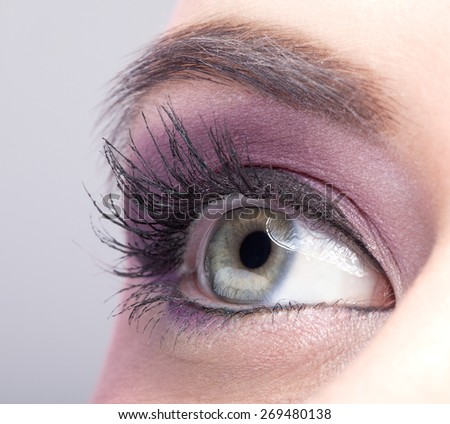 Close-up shot of female eye make-up in pink color - stock photo