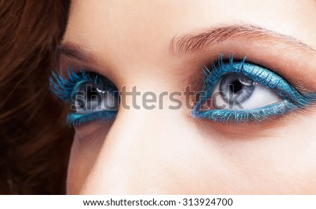 Close-up shot of female eyes blue color make-up - stock photo