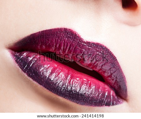 Close-up shot of female lips with bicolor marsala lipstick - stock photo