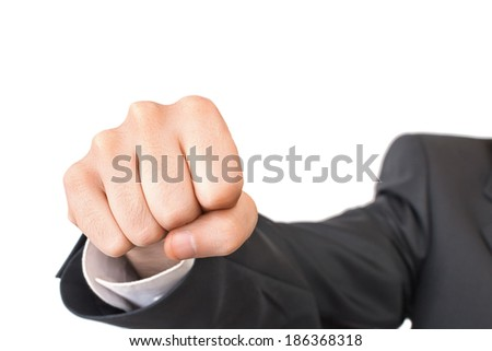 Close-up shot of fist beating to camera - isolated on white - stock photo