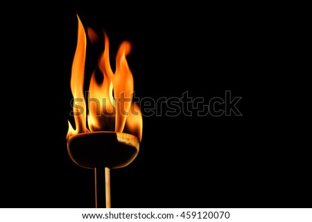 close up shot of flaming torch and fire.
