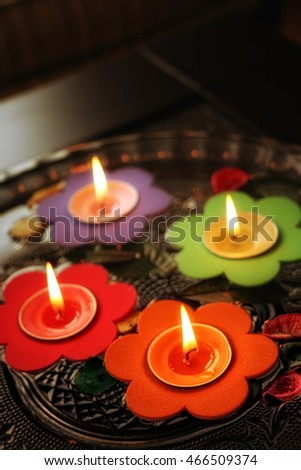 close up shot of floating candles in glass bowl.