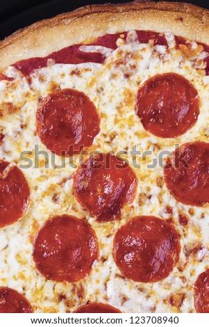 Close-up shot of fresh baked pepperoni pizza - stock photo