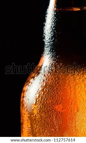 Close up shot of frosty beer bottle - stock photo