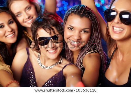 Close-up shot of group of partying girls having fun - stock photo