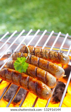 Close up shot of Italian sausage on the grill - stock photo