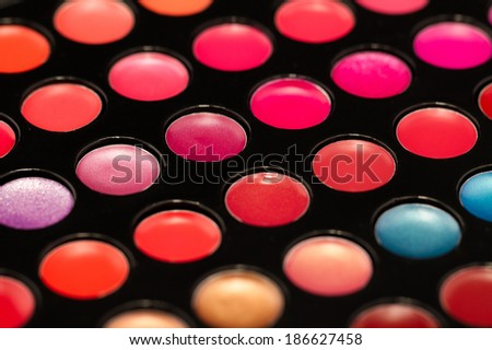 Close-up shot of lip gloss palette, soft focus - stock photo
