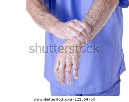 Close-up shot of male surgeon washing his hands with soap - stock photo