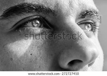 Close-up shot of man's eye. Man with blue eyes. - stock photo