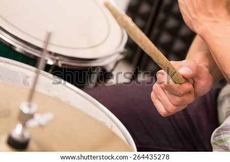 close up shot of musician playing drums - stock photo