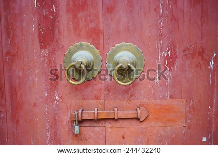 Close-up shot of old red chinese door - stock photo