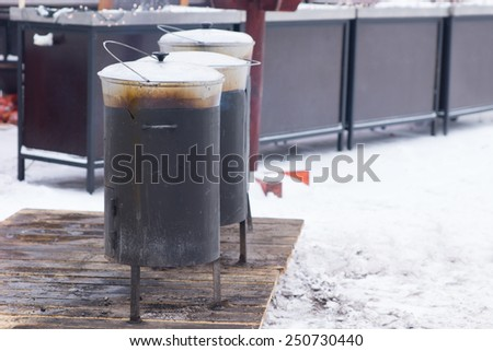 Close up Shot of Outdoor Cooking Using Pots During Winter Season - stock photo