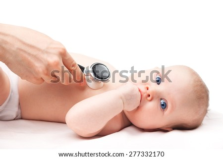 Close-up shot of pediatrician examines three month baby girl. Doctor using a stethoscope to listen to baby's chest checking heart beat. Child is looking at camera sucking hand. - stock photo