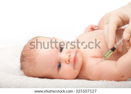 Close-up shot of pediatrician giving a three month baby girl  intramuscular injection of a vaccine in arm