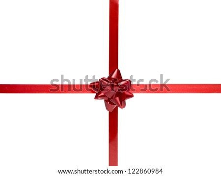 Close-up shot of red shiny gift bow on red ribbon forming plus sign. - stock photo