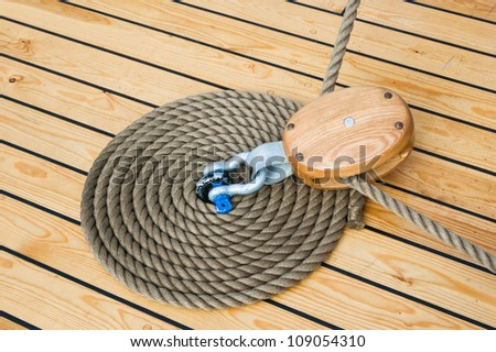 Close-up shot of rope. Taken at a shipyard. - stock photo