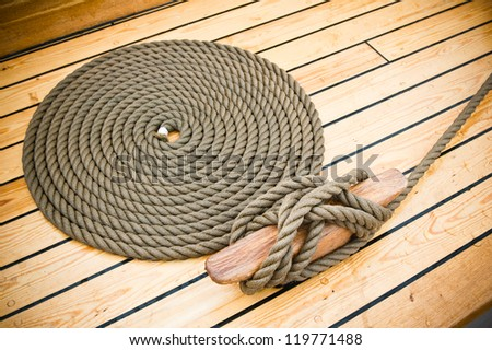 Close-up shot of rope. Taken at a shipyard. - stock photo