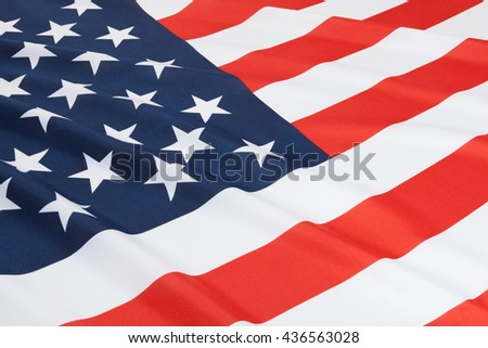 Close up shot of ruffled national flags series - United States - stock photo