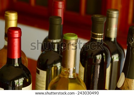Close up shot of several bottles of wine - stock photo