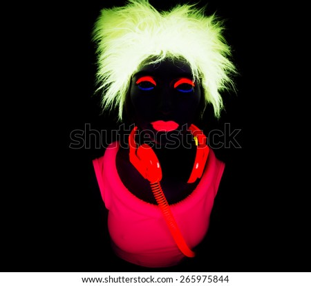 close up shot of sexy female disco dancer poses in UV costume - stock photo