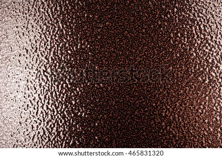 close up shot of shiny brown metal surface.