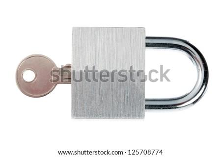 Close-up shot of shiny metal padlock and key over plain white background. - stock photo