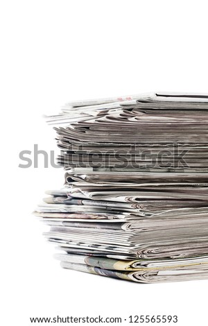 Close-up shot of stack of newspapers for recycle on white background