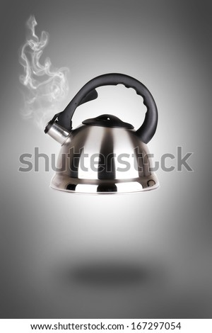 Close up shot of steaming tea kettle. - stock photo