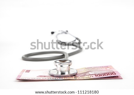 Close up shot of stethoscope on indonesia rupiah paper money isolated on white - stock photo