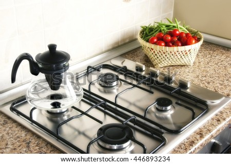 close up shot of stove in domestic kitchen - stock photo