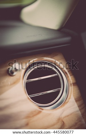 Close up shot of the air vent from a luxury car.