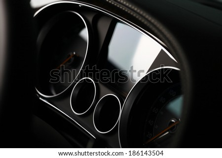 Close up shot of the dashboard a car. - stock photo