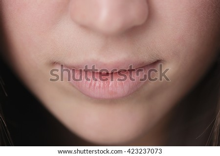 Close up shot of the full lips young woman