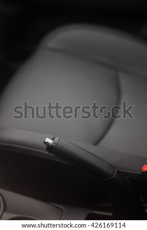 Close up shot of the hand brake of a car.