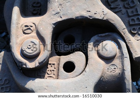close-up shot of the metal coupling between two train cars - stock photo