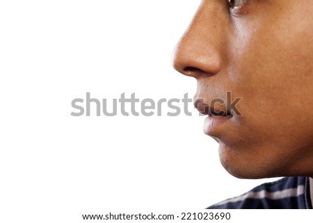 close up shot of the nose and mouth of a dark-skinned young man - stock photo