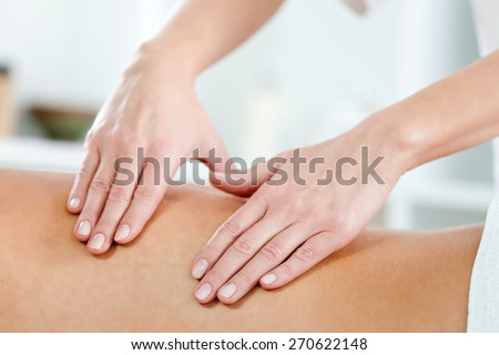 Close up shot of therapist hand doing massage on spa treatment