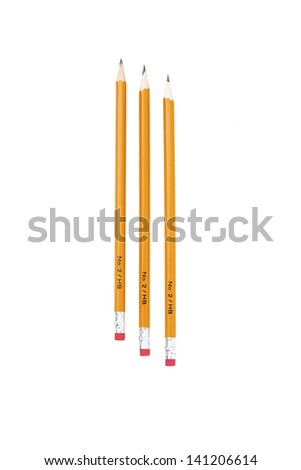 Close-up shot of three yellow sharp pencils arranged in a row over white background. - stock photo