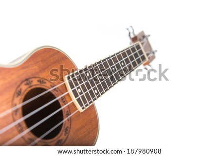 Close-up shot of ukulele guitar, isolated on white background